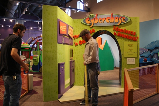 museum team works on cyberchase exhibit